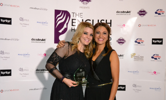Katie May and Jade May receiving English Hair & Beauty Award
